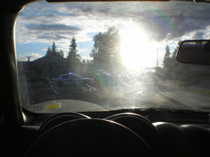 Photo of sun glare through driver's side windshield.
